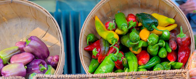 Organic peppers in baskets at the market Stock Photo