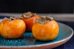 Organic persimmons Royalty Free Stock Photography