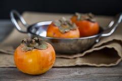 Organic persimmons Stock Image