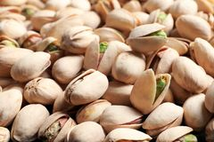 Organic pistachio nuts in shell as background. Closeup royalty free stock photos