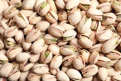 Organic pistachio nuts in shell as background. Top view royalty free stock photography