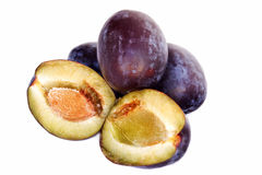 Organic Plums. Isolated on white background Royalty Free Stock Photos