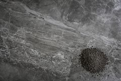 Organic Poppy Seeds on a marble kitchen worktop background stock photography