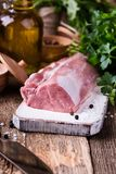 Organic pork meat. On chopping board and food ingredients ready for cooking, rustic style, selective focus Stock Image