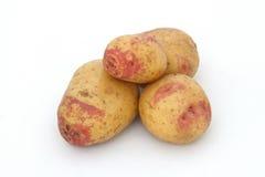 Organic potatoes. On a white background Royalty Free Stock Photo