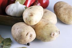 Organic Potatoes. Organic Raw Potatoes on White Table with Some Other Vegetables in Background. Potatoes Horizontal Photo Stock Photos