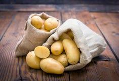 Organic potatoes in the burlap sack Stock Photography