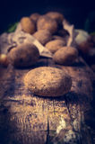Organic potatoes from garden on rustic kitchen table Royalty Free Stock Photography