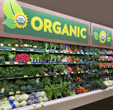 Organic Produce Market. Organic produce display in supermarket Stock Photo