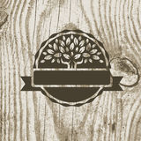 Organic product badge with tree on wooden texture. Vector illust Royalty Free Stock Photos