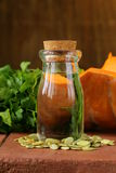 Organic pumpkin oil in a glass jar Royalty Free Stock Images
