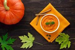 Organic pumpkin puree (soup)in a white bowl Stock Photos