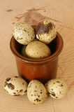Organic quail eggs in a brown bowl. Some  organic quail eggs in a brown bowl Stock Photo