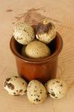 Organic quail eggs in a brown bowl Stock Photo