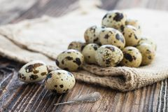 Organic quail eggs. And jute bags. Natural gourmet meal stock photography