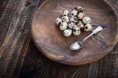 Organic quail eggs. On the wooden plate. Natural gourmet meal royalty free stock photos