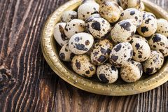 Organic quail eggs. On the vintage plate. Natural gourmet meal royalty free stock photos