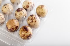 Organic quail bird eggs. Organic quail eggs on the white background. Natural gourmet meal stock image