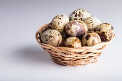 Organic quail eggs. On the white background. Natural gourmet meal stock photography