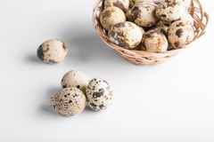 Organic quail eggs. On the white background. Natural gourmet meal royalty free stock photo