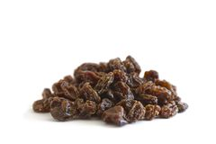 Organic Raisins. A pile of raisins on white background royalty free stock image