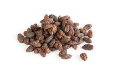 Organic raisins. A heap of organic raisins on white background Stock Photography