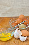 Organic and range free, chicken eggs and whisk Stock Photo