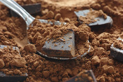 Organic raw cocoa powder with chocolate Royalty Free Stock Photography