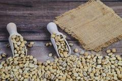 Free Organic Raw Coffee Beans In Wood Spoon On Wood Stock Image - 160221761