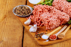 Organic Raw Grass Fed Ground Beef. Grass Fed Organic Raw ground beef with spices Royalty Free Stock Images