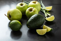Organic Raw Green avocado, apples and limes Stock Photo
