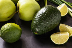 Organic Raw Green avocado, apples and limes Royalty Free Stock Image