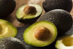 Organic Raw Green Avocados. Sliced in Half Royalty Free Stock Image