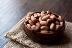 Organic Raw Hazelnuts in Wooden Bowl. Organic Food Royalty Free Stock Image