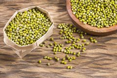 Green mung beans in bowl - Vigna radiata. Organic and raw mung - Wooden background. Vigna radiata stock photography