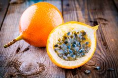 Organic raw ripe yellow granadilla passion fruit Royalty Free Stock Photo