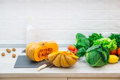Organic raw vegetables. Sliced fresh vegetables with pumpkin. On rustic background stock photo