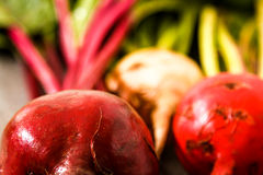 Organic red beets with green leaves on an old wooden table. Rust. Organic red beets with green leaves on an old wooden table Royalty Free Stock Photography