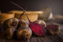 Organic red beets on an old wooden table. Rustic style. Close up Royalty Free Stock Images