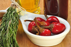 Organic red cherry paprika in sunflower oil Royalty Free Stock Images