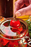 Organic red cherry paprika in sunflower oil Stock Images