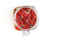 Organic red chili in a jar Stock Image