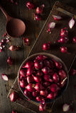 Organic Red Pearl Onions Stock Photography