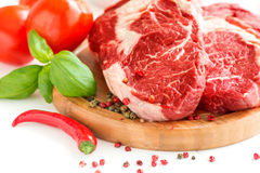 Organic Red Raw Steak on board Stock Images