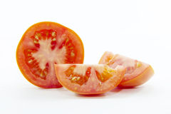 Organic red tomato pieces sliced ingredient Royalty Free Stock Photography