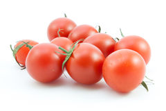 Organic red tomatoes on white Stock Photo