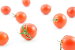 Organic red tomatoes on white Royalty Free Stock Photos