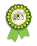 100% organic ribbon rosette. 100% organic green ribbon rosette on white background, for web design or advertising, vector illustration, eps 10 with transparency Royalty Free Stock Photography
