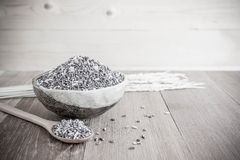 Organic rice in ceramic cup  and wooden spoon - soft focus Royalty Free Stock Images