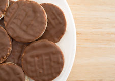 Organic rice cookies with milk chocolate icing on plate Royalty Free Stock Images